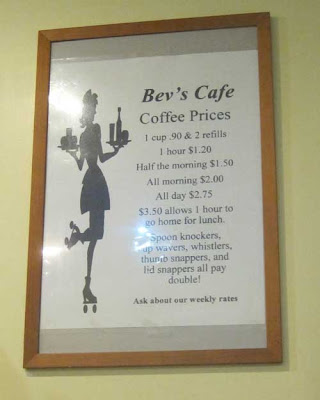 Bev's Cafe coffee price sign, $.90 per cup plus two refills, $1.20 per hour, $1.50 half morning, $2.00 all morning, $2.75 all day, $3.50 allows 1 hour to go home for lunch