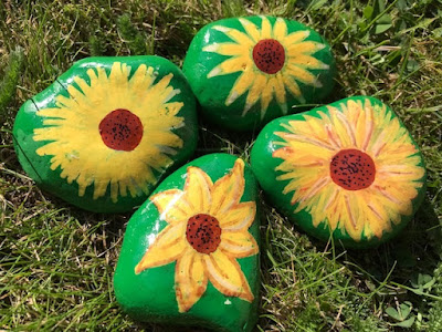 Painted sunflower rocks