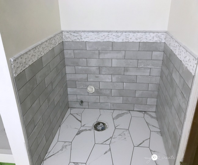 tiled wall around toilet