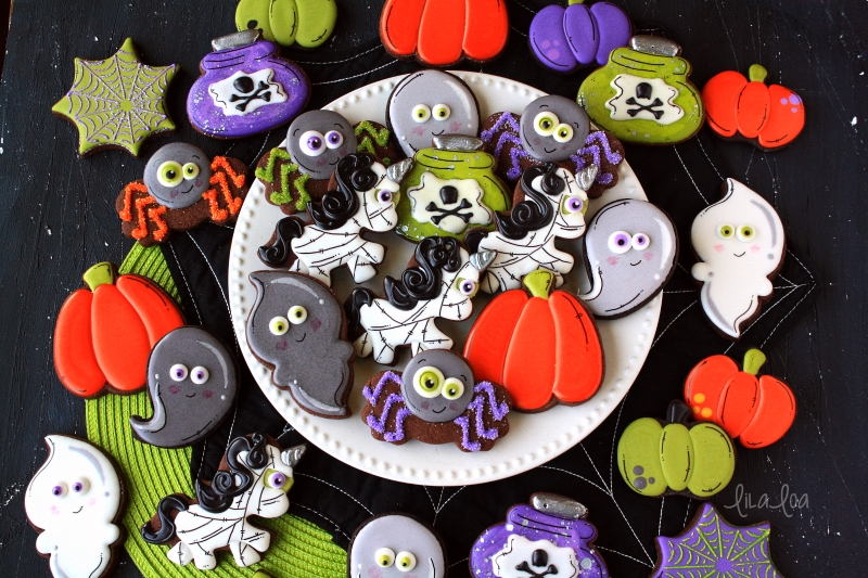 Halloween decorated chocolate sugar cookies -- pumpkins, ghosts, mummy unicorns, spiders, and spider webs