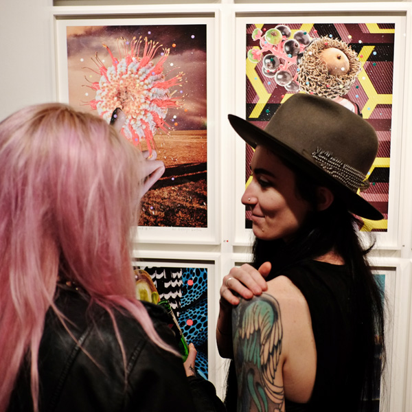 Street fashion, pink hair, hat with feather, angel wing tattoo. Opening night crowd at Roslyn Oxley9 gallery for 'angel dribble' by Del Kathryn Barton.