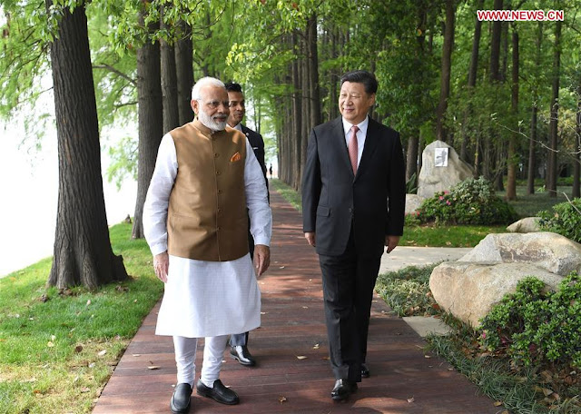 China is forced to court India