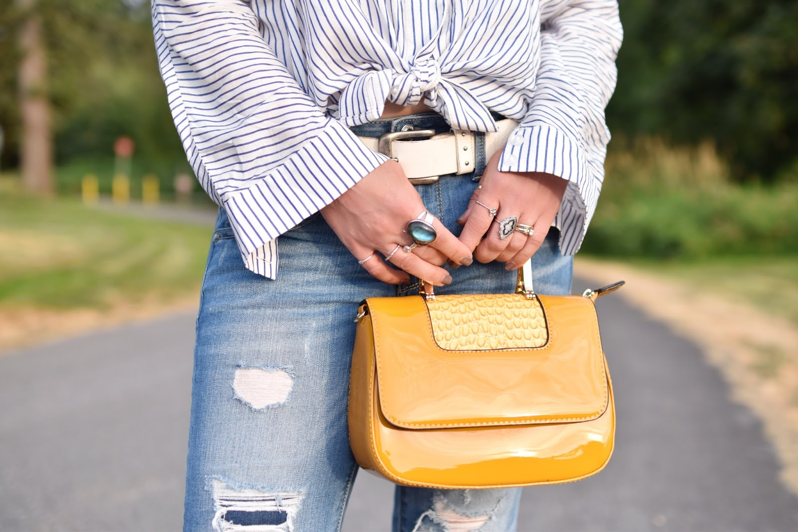Monika Faulkner personal style inspiration - off-the-shoulder striped shirt, distressed cropped jeans, yellow patent mini-bag