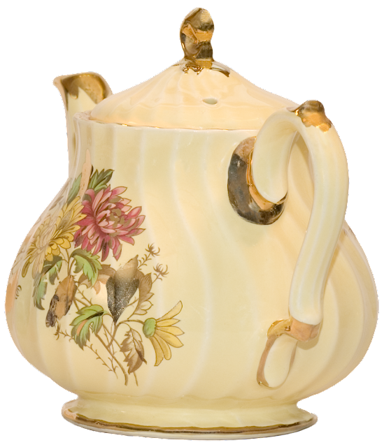 A floral teapot seen from the back.