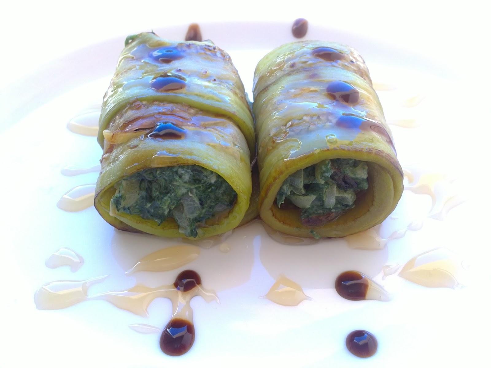 Rollitos de berenjena con espinacas, tomates secos, piñones y jamón