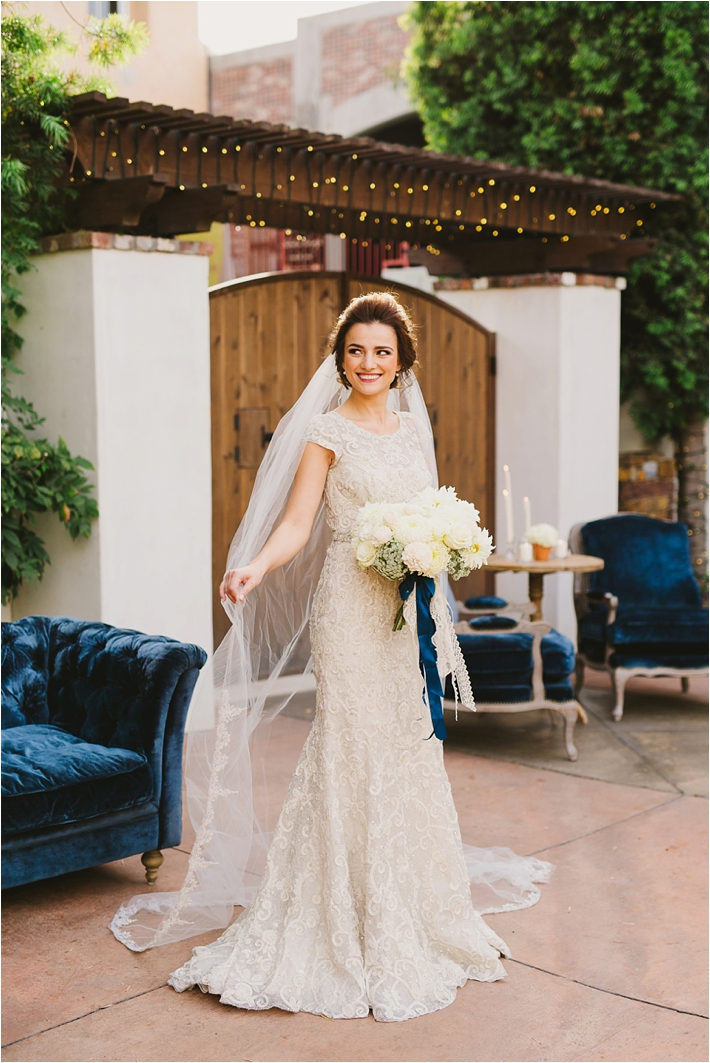 Bride in elegant lace gown with long veil // Photo by Closer to Love Photography // Gown by Enaura Bridal // Veil by Blossom Veils via @thesocalbride