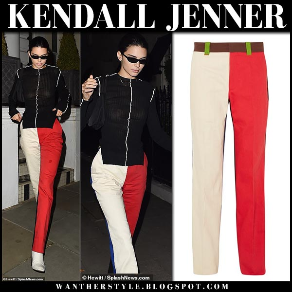 Kenall Jenner in black top and red and beige pants color block calvin klein model fashion week style september 17
