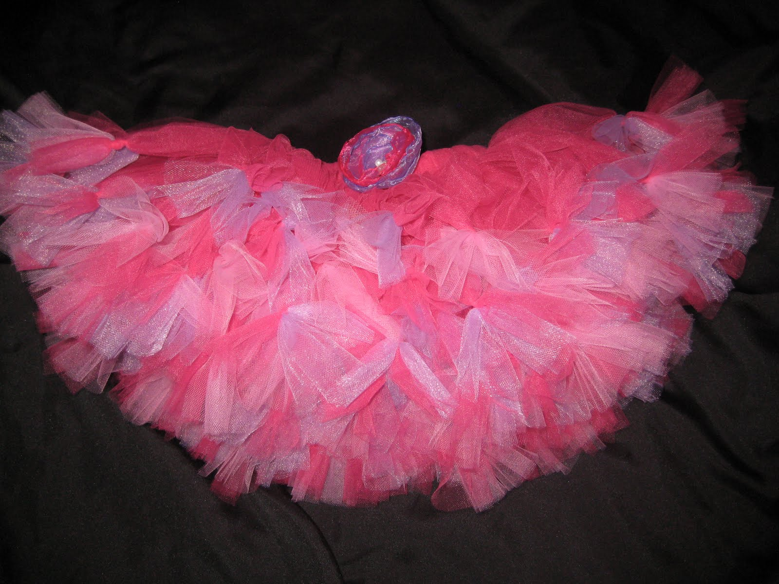 640edccfab6 Skirt is made of soft white tulle with fuschia