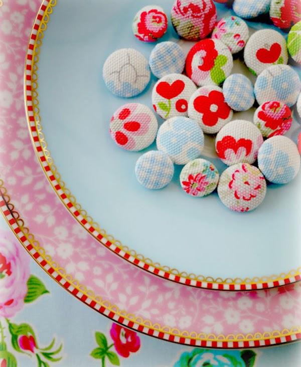 Floral fabric covered buttons on pip studio plates