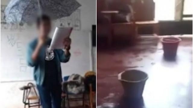 Estudante usa guarda-chuva dentro da sala de aula por causa de goteiras em escola na Bahia