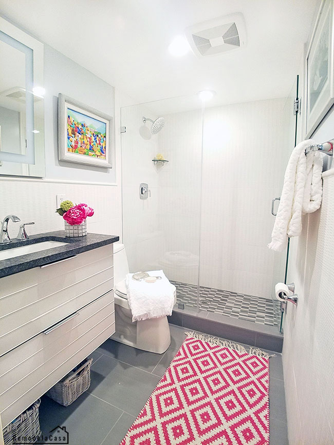 white and grey bathroom makeover with pops of fuchsia