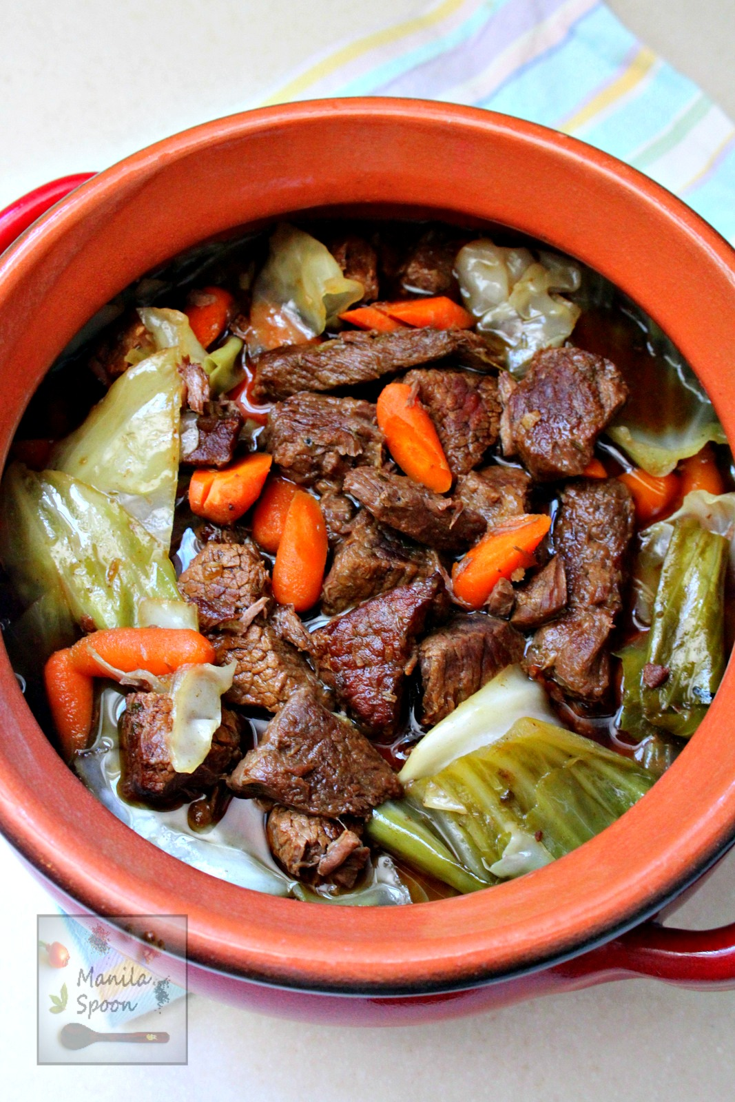 Beef chunks are steeped in Belgian beer in the slow cooker and results in a melt-in-your-mouth delicious stew! This is the best beef stew ever! | manilaspoon.com