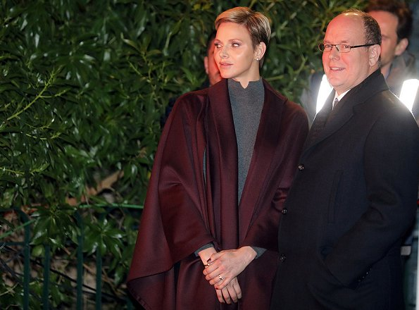 Princess Charlene and Prince Albert attend the traditional 2017 Sainte Devote procession in Monaco. Wore Akris cape