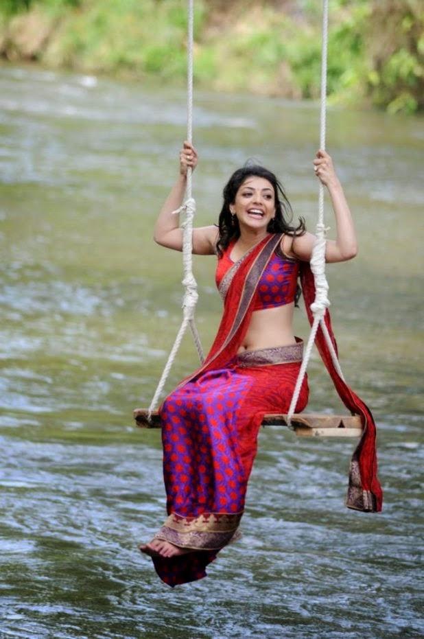 Kajal Agarwal In Swing Showing Navel