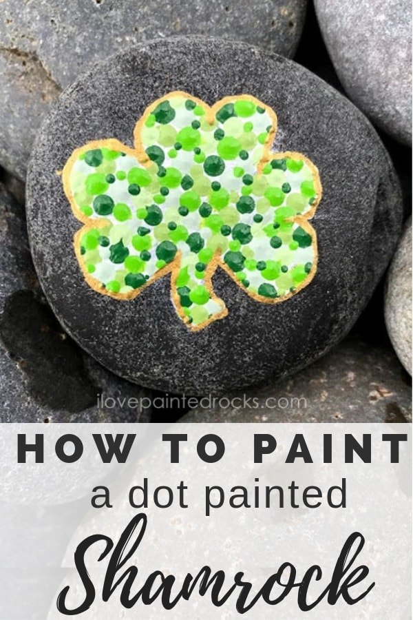 How to paint a shamrock silhouette painted rock for St Patrick's Day. This is an easy St Patrick's Day craft that anyone can make with a rock and some paint. #ilovepaintedrocks #stpatricksday #stpatricksdaycraft #shamrockcraft #shamrock #dotpainting