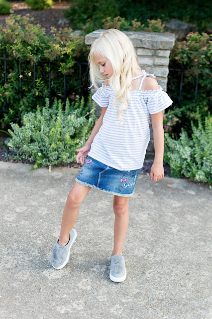 little girl fashion outfit denim skirt patches fur pom shoes sneakers off the shoulder