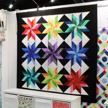 Spinwheels Quilt Free Pattern designed by Kimberly Einmo of Timeless Treasures
