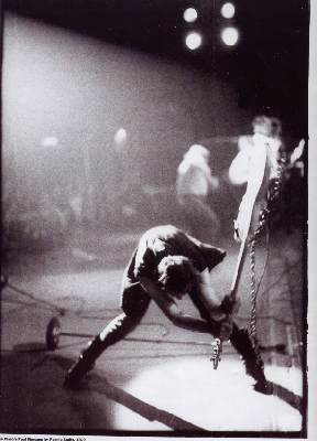 Paul Simonon breaking his bass guitar