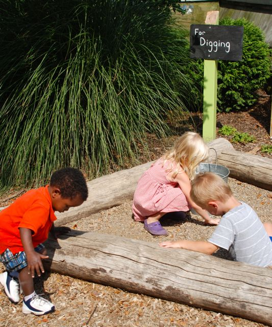 I love their use of slate signs with chalk to label the areas... something that might even be fun at home to use in playtime as a chalk board. Our kids were having a blast just digging in the gravel.