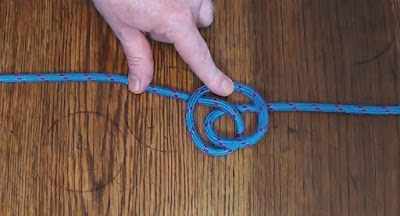 Forming an alpine butterfly in blue paracord