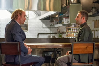 Rhys Ifans as Mycroft Holmes with Jonny Lee Miller as Sherlock Holmes in CBS Elementary Season 2 Episode 7 The Marchioness