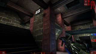 screenshot of Unreal Tournament on the map DM-Turbine holding a Shock Rifle in a Team Deathmatch