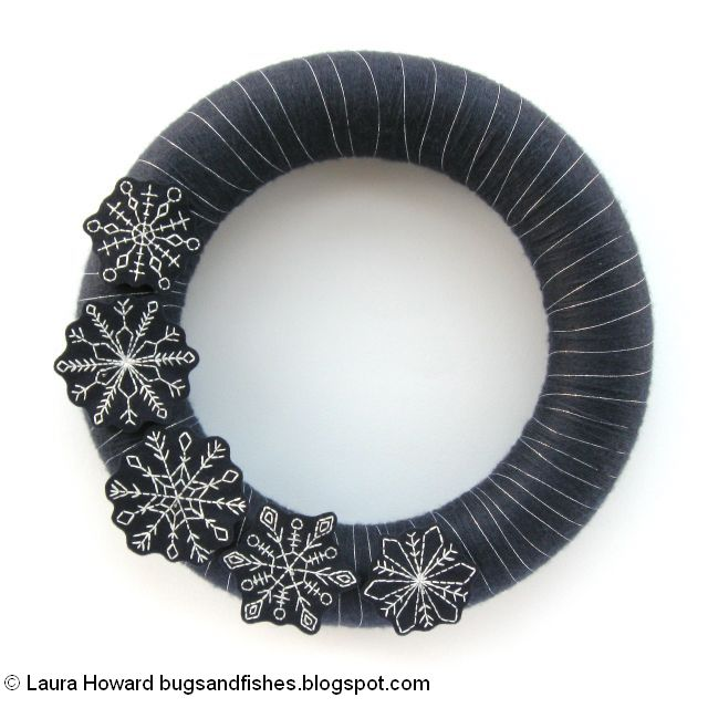 arrange the embroidered snowflakes on the wreath