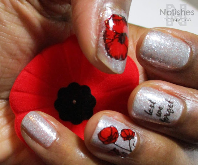 red white and black poppy themed manicure for remembrance day