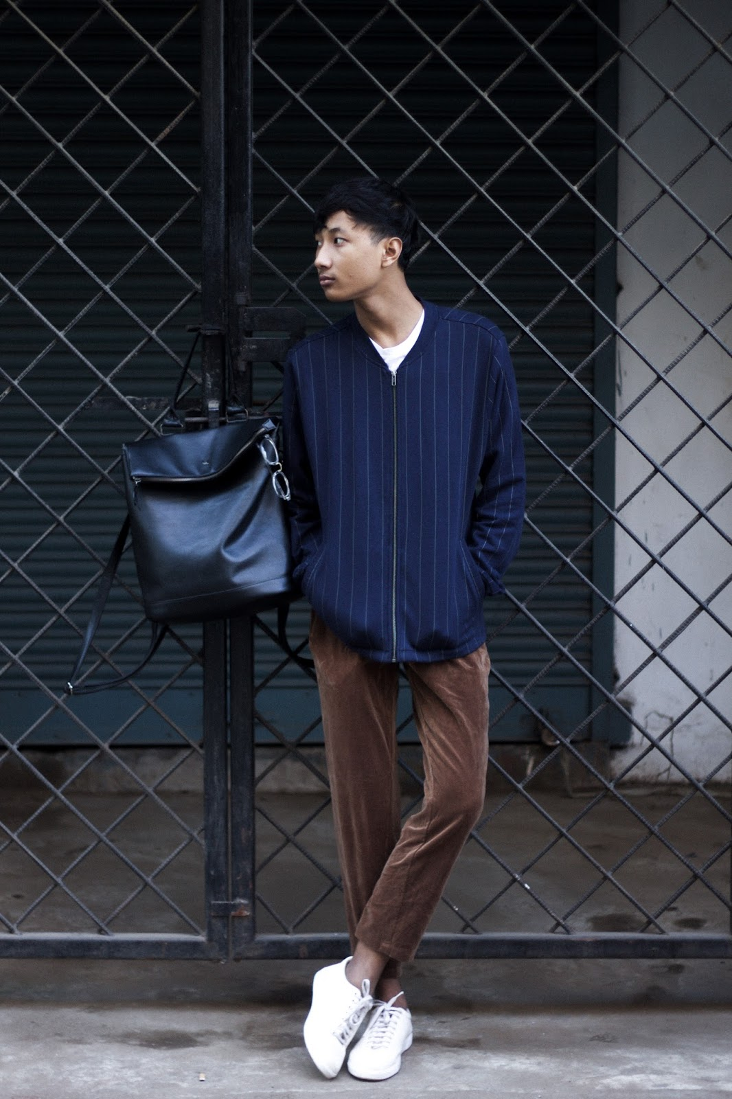 TheQuirkyMinimal by Kangkan Rabha Indian Menswear fashion blog Stripes and Suede outfit post Wearing Koovs Straight Hem Stripe Jacket & white tee, Thrifted suede pants, Berfolk tote backpack & BEONZA White Sneakers