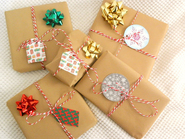 A pile of Christmas Presents all wrapped using brown paper and string