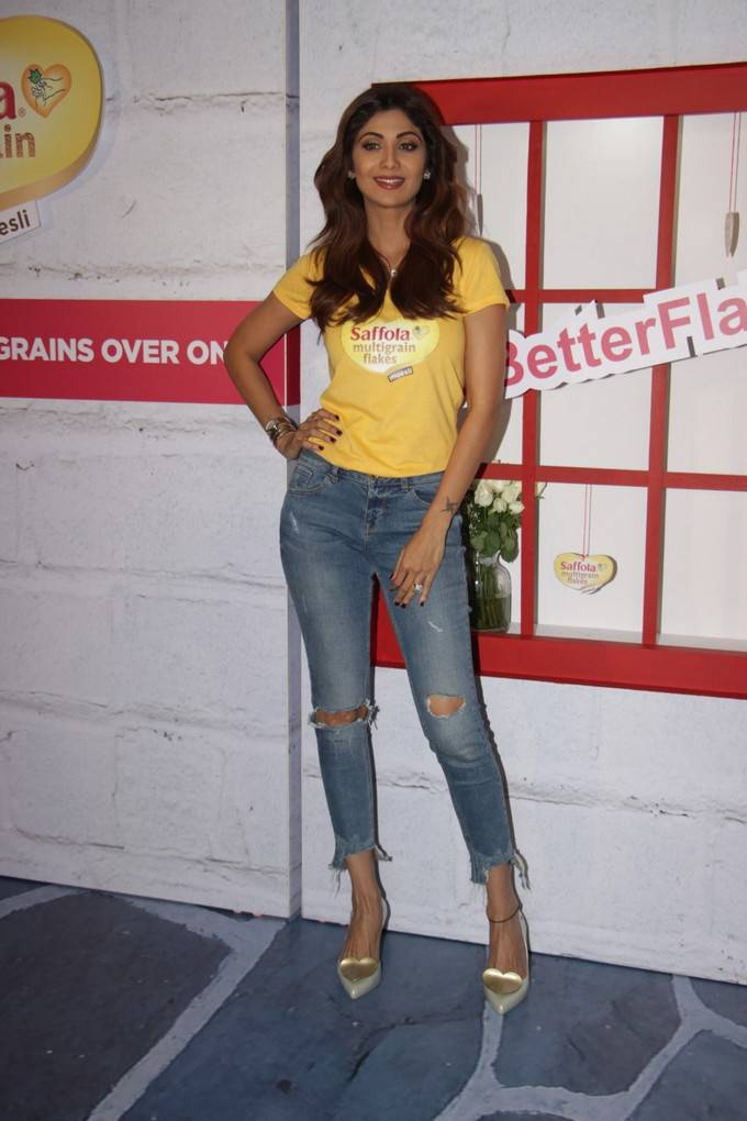 Shilpa Shetty Stills In Yellow Top Blue Jeans