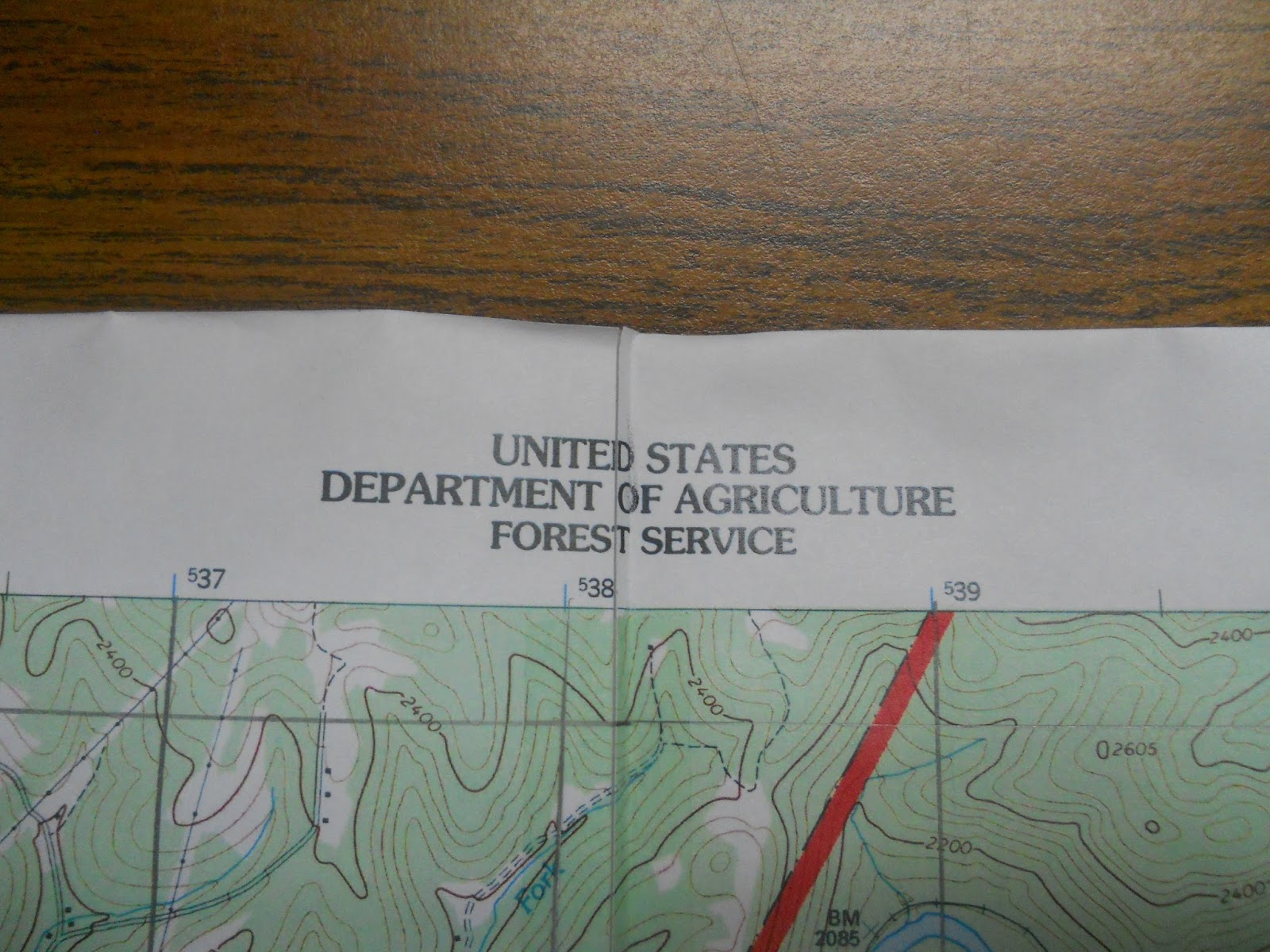 on the center portion of the top of the map will be listed either the map series as with the newer us topo maps or the secondary agency responsible for