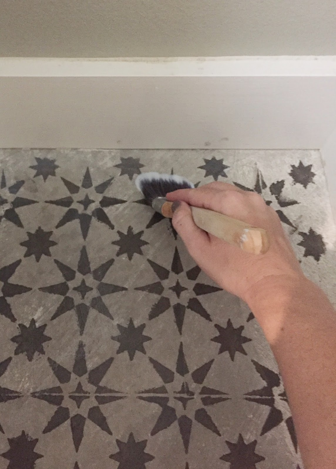 DIY stenciled tile project. A great way to get the look of expensive cement tiles.