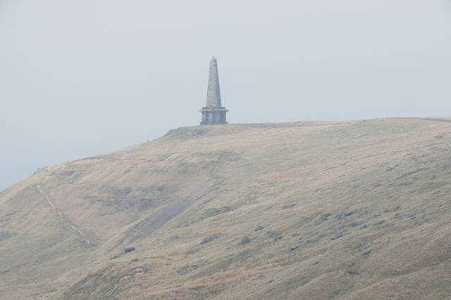 On the edge of Higher Moor, Stoodley Pike monument - a squat stone base surmounted by a obelisk-like structure.