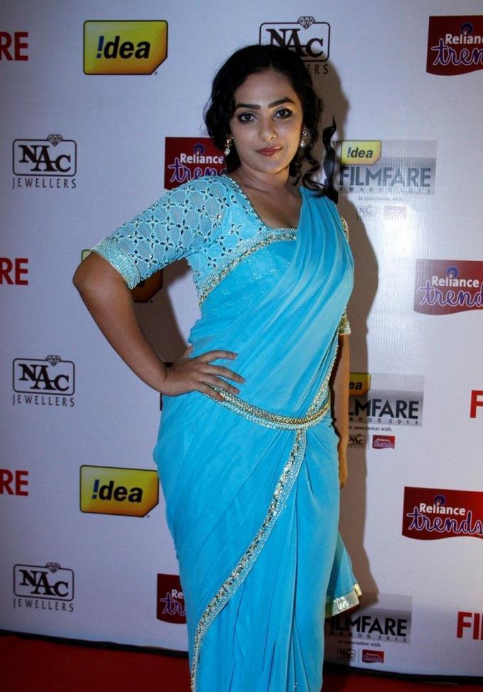 Actress Nithya Menen Stills In Blue Sari At Idea Film fare Awards