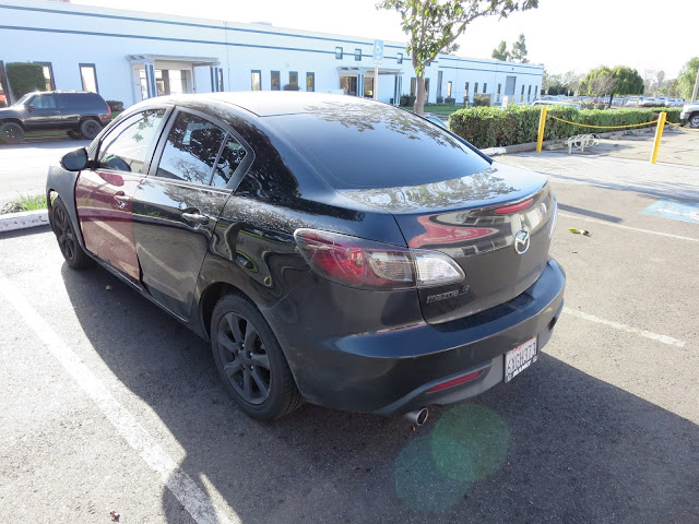 Mazda 3 with peeling Plasti Dip before repainting at Almost Everything Auto Body