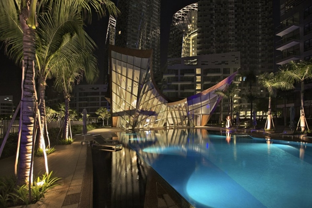 pool of the Reflections at Keppel Bay by Studio Daniel Libeskind at night