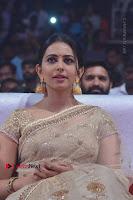 Actress Rakul Preet Singh Stills in Golden Embroidery saree at Rarandoi Veduka Chuddam Audio Launch .COM 0018.jpg