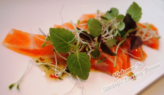 salmon sashimi with shiso and alfalfa