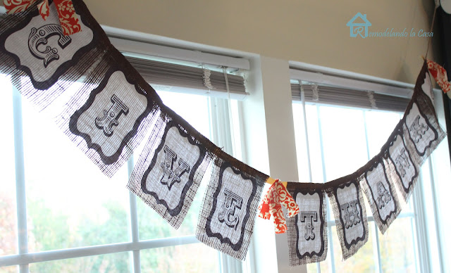 burlap and paper Give thanks banner on window