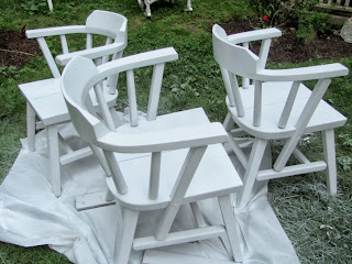white spray painted chairs outside