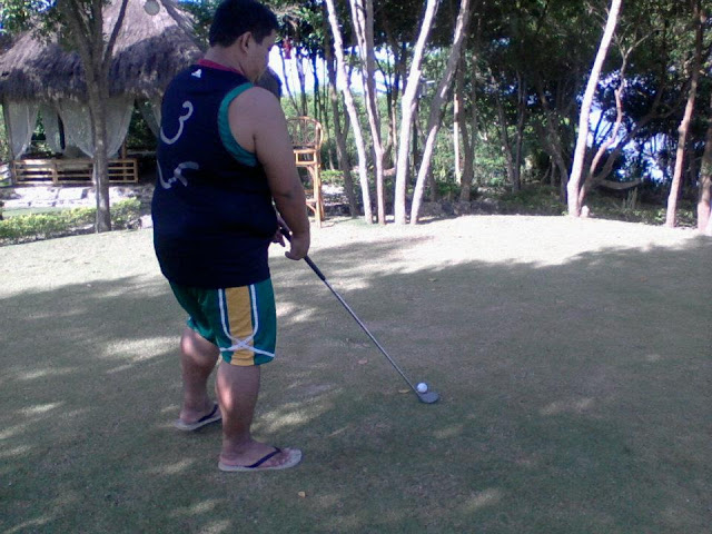 playing golf at Hale Manna Beach Resort
