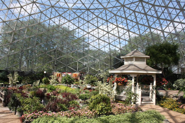 Walking through a brilliant garden in all seasons in the Floral Show Dome at Mitchell Park Domes in Milwaukee, Wisconsin.