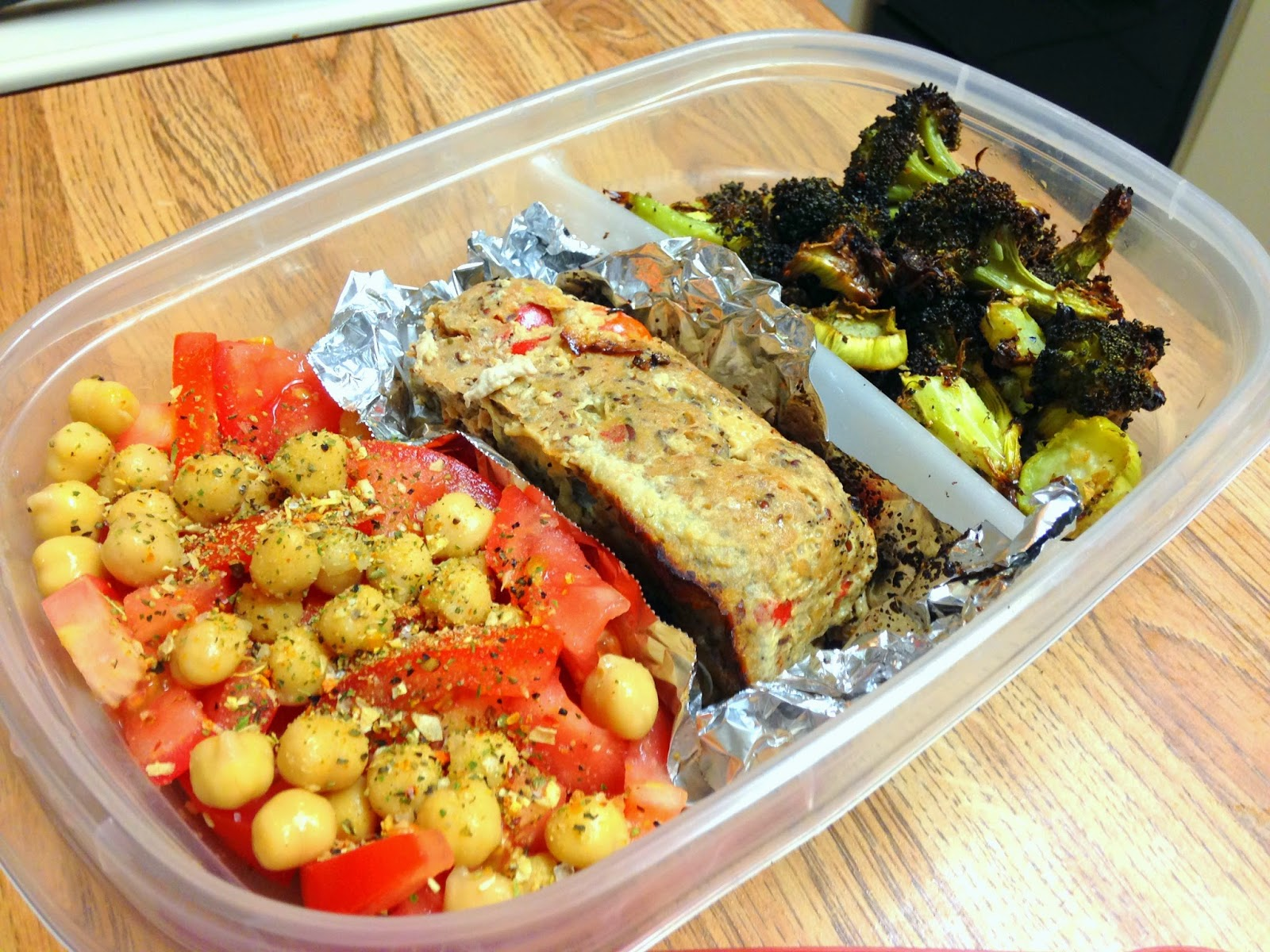 Easy leftover lunch from Hungry Gator Gal: south of the border turkey meatloaf, roasted broccoli, and a chickpeas/diced tomato mixture topped with red wine vinegar and Trader Joe's 21 Seasoning Salute.