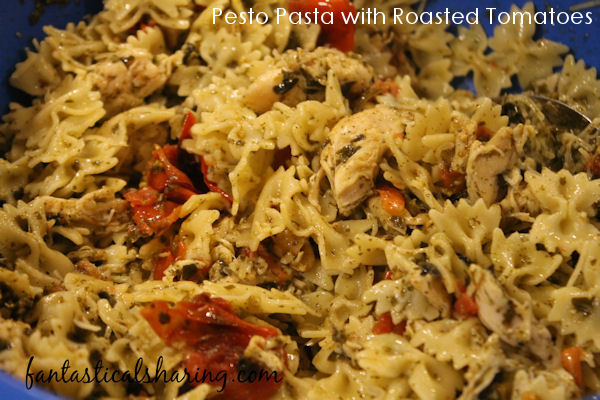 Pesto Pasta with Roasted Tomatoes // An easy and quick dinner to throw together with loads of pesto and fabulous roasted tomatoes #recipe #pesto #chicken #pasta #maindish