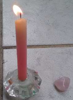 prayer candle and crystal; photo by author Juli D. Revezzo