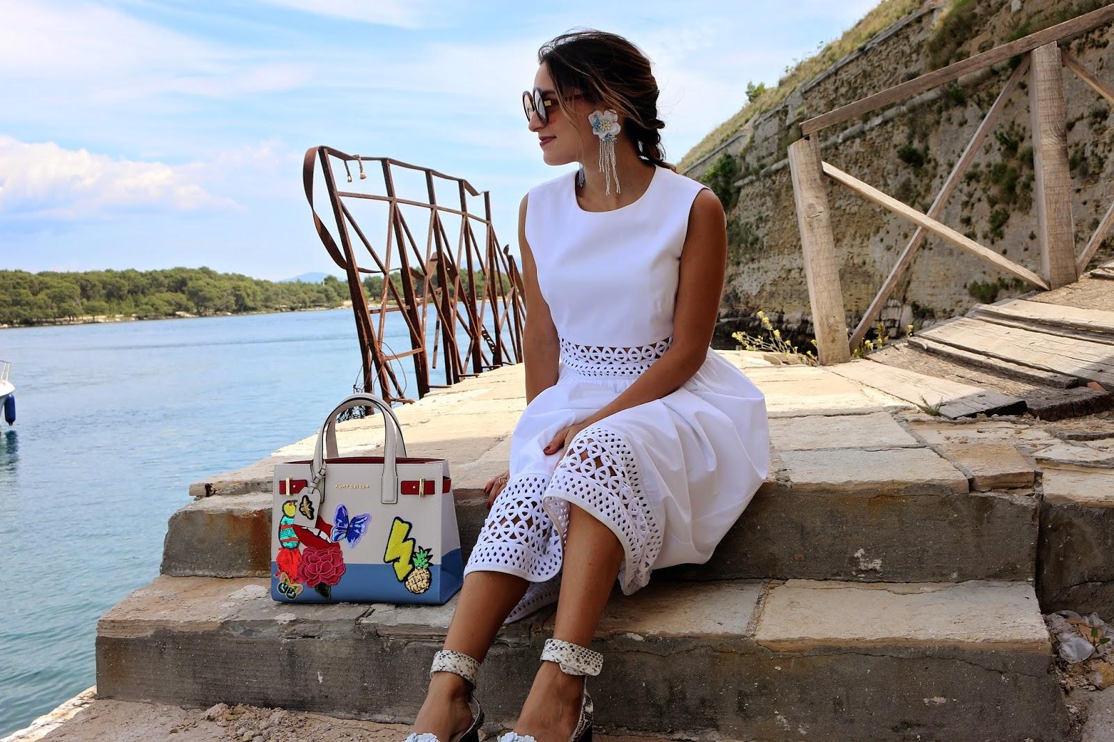 Whitney's Wonderland's Whitney Valverde UK Top Fashion Blogger wears Ted Baker cut work white midi dress, Kurt Geiger saffiano tropical embellished bag and flatforms in Sibenik, Croatia.