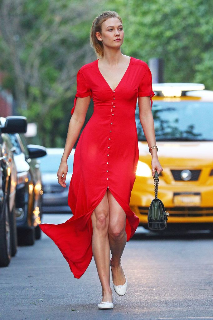 Karlie Kloss street style in a bright red button up dress in New York
