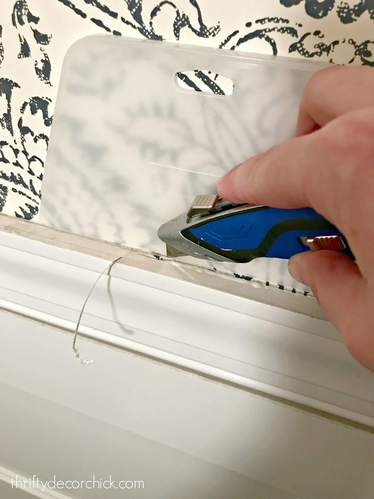 Tips for hanging wallpaper around trim