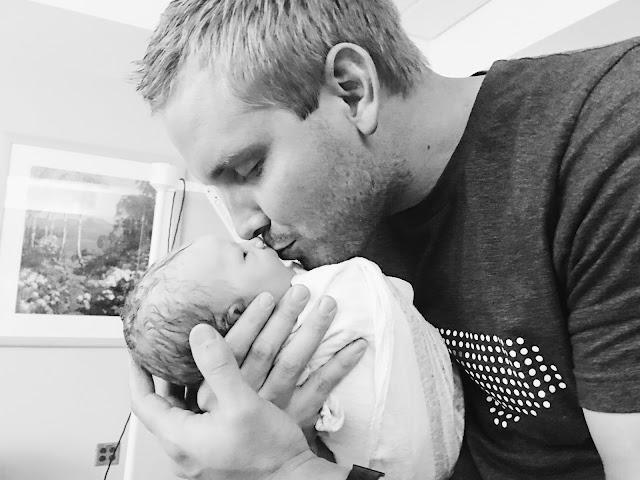 father-kissing-newborn